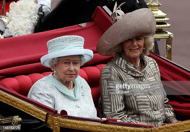 Queen Elizabeth II and Camilla Duchess of Cornwall look on during the Diamond Jubilee carriage procession after the service of thanksgiving at...
