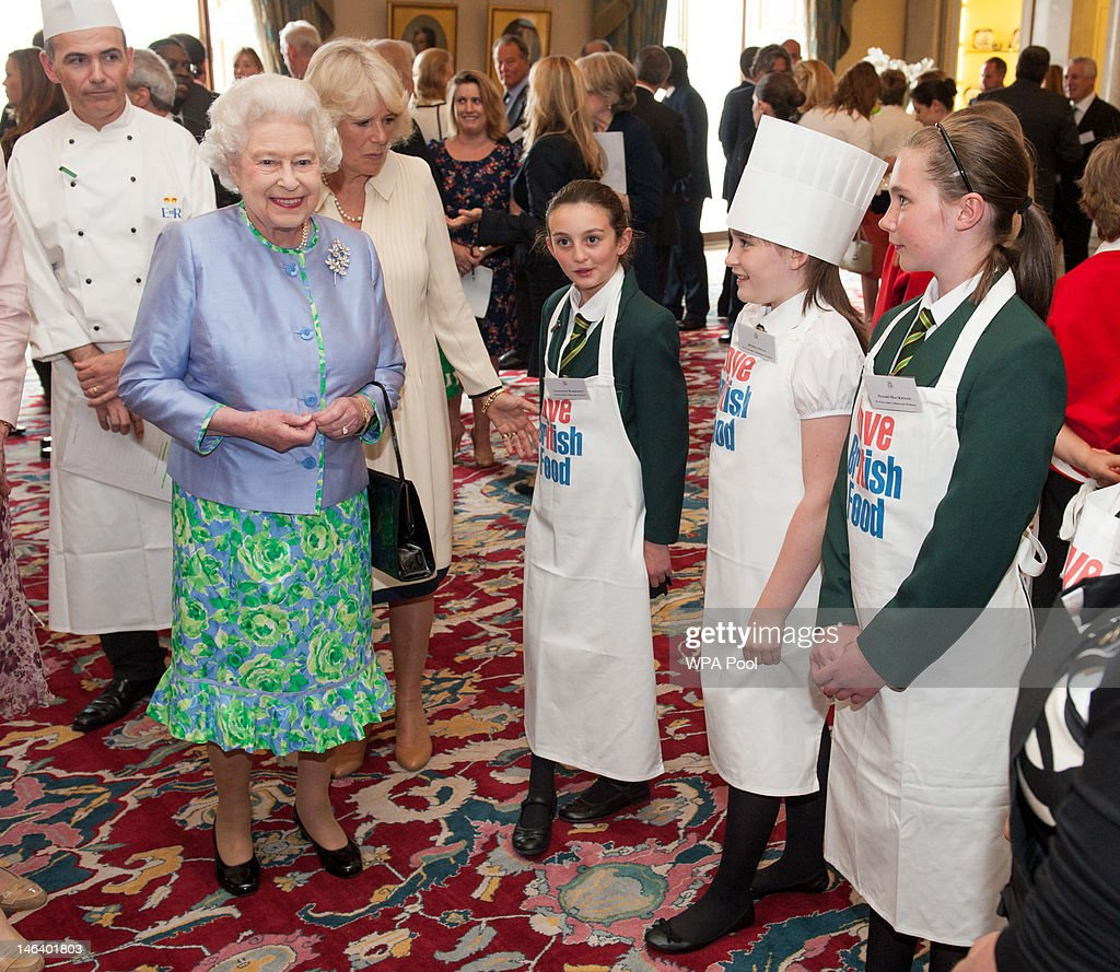 Queen Elizabeth II and Camilla, Duchess of Cornwall meet pupils from St Columba's Primary School during a reception at Buckingham Palace on June 15, 21012 in London, England. Queen Elizabeth II and the Duchess of Cornwall met winners of the 'Cook for the Queen' competition, who created the menu served at a reception at Buckingham Palace.
