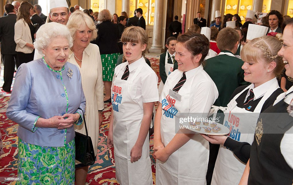 Queen Elizabeth II and Camilla, Duchess of Cornwall meets pupils from Latimer Arts College, in Northamptonshire at a reception at Buckingham Palace on June 15, 21012 in London, England. Queen Elizabeth II and the Duchess of Cornwall met winners of the 'Cook for the Queen' competition, who created the menu served at a reception at Buckingham Palace.