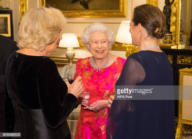 Queen Elizabeth II and Camilla Duchess of Cornwall speak to Princess Zahra Aga Khan prior to dinner at Windsor Castle on March 8 2018 in Windsor...