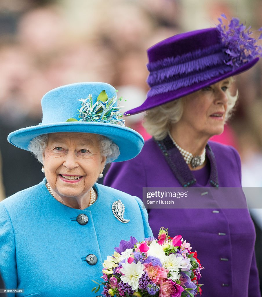 Queen Elizabeth II and Camilla, Duchess of Cornwall tour Queen Mother Square on October 27, 2016 in Poundbury, Dorset.