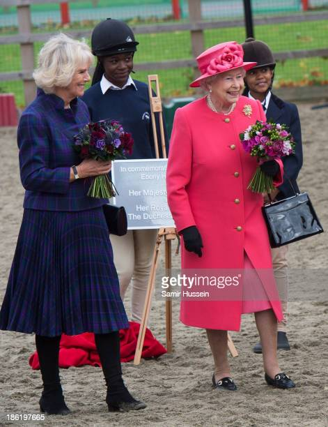 Queen Elizabeth II and Camilla Duchess of Cornwall visit Ebony Horse Club And Community Riding Centre Brixton on October 29 2013 in London England