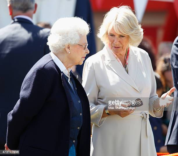 Queen Elizabeth II and Camilla Duchess of Cornwall watch The Queen's horse 'Tower Bridge' come 3rd in The Cuddy Heavyweight Hunter class as they...