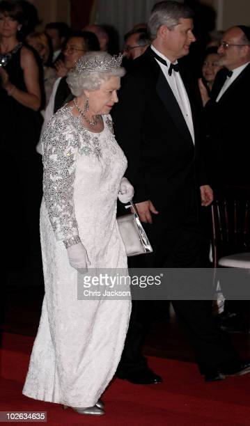 Queen Elizabeth II and Canadian Prime Minister Stephen Harper arrive at a dinner at the Royal York Hotel on July 5 2010 in Toronto Canada The Queen...