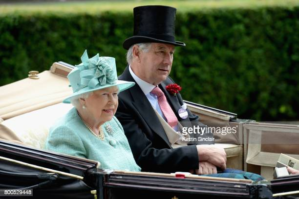 Queen Elizabeth II and Captain David BowesLyon arrive in the Royal Procession on day 4 of Royal Ascot at Ascot Racecourse on June 23 2017 in Ascot...