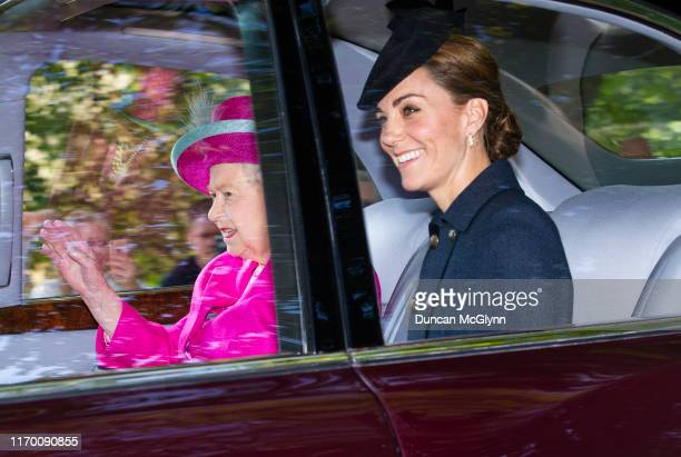 Queen Elizabeth II and Catherine, Duchess of Cambridge are driven to Crathie Kirk Church before the service on August 25, 2019 in Crathie,...