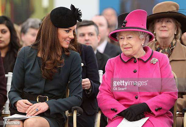 Queen Elizabeth II and Catherine, Duchess of Cambridge watch a fashion show at De Montfort University on March 8, 2012 in Leicester, England. The...