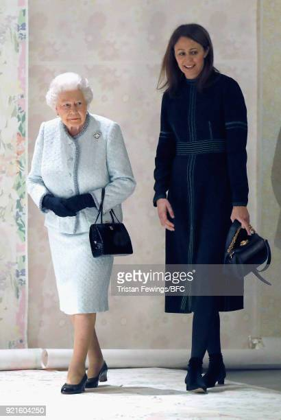 Queen Elizabeth II and Chief Executive of the British Fashion Council Caroline Rush attend the Richard Quinn show during London Fashion Week February...