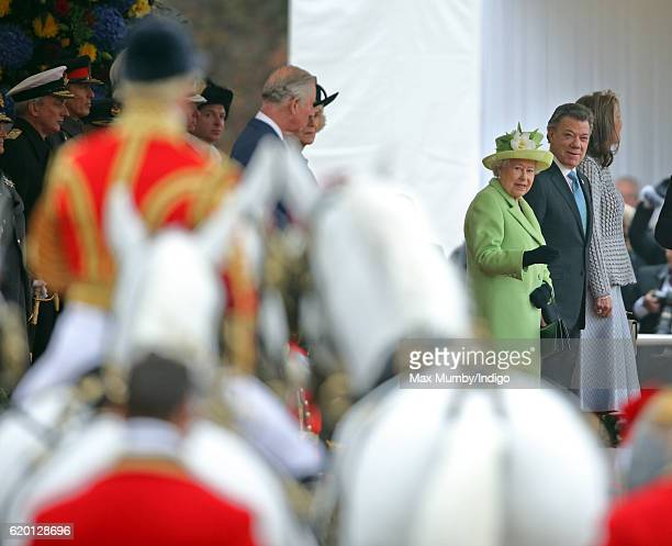 Queen Elizabeth II and Colombian President Juan Manuel Santos attend the Ceremonial Welcome for the President of Colombia at Horse Guards Parade on...