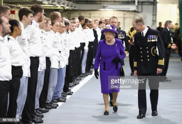 Queen Elizabeth II and Commanding Officer Jerry Kyd attend the Commissioning Ceremony of HMS Queen Elizabeth at HM Naval Base on December 7 2017 in...