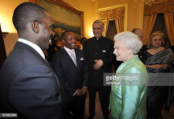 Queen Elizabeth II and Commonwealth Secretary General Kamalesh Sharma meet footballer Dwight Yorke and cricketer Brian Lara at the Commonwealth Day...