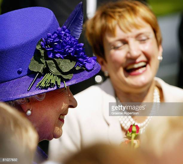 Queen Elizabeth II and Culture Secretary Tessa Jowell share a joke as they attend the opening of the Diana Memorial Fountain in memory of the late...