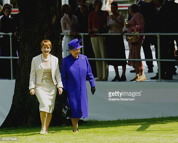 Queen Elizabeth II and Culture Secretary Tessa Jowell stroll as they attend the opening of the Diana Memorial Fountain in memory of the late Princess...