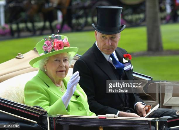 Queen Elizabeth II and David ArmstrongJones Earl of Snowdon arrive in the Royal procession on day 4 of Royal Ascot at Ascot Racecourse on June 22...