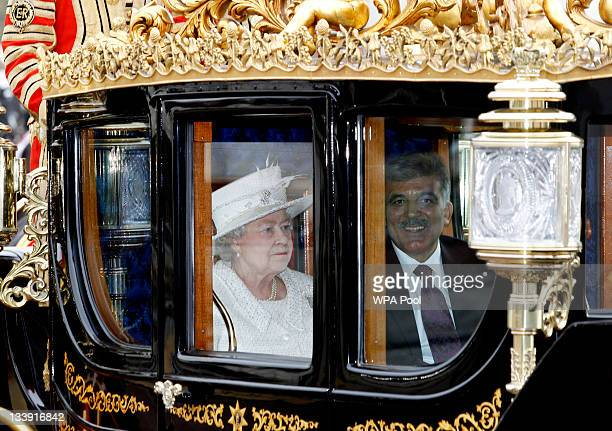 Queen Elizabeth II and Dr Abdullah Gul the President of the Republic of Turkey arrive in the Royal Carriage as they arrive at Buckingham Palace on...