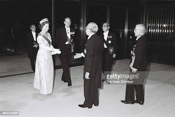 Queen Elizabeth II and Duke of Edinburgh are welcomed by Emperor Hirohito prior to the state dinner at the Imperial Palace on May 7, 1975 in Tokyo,...