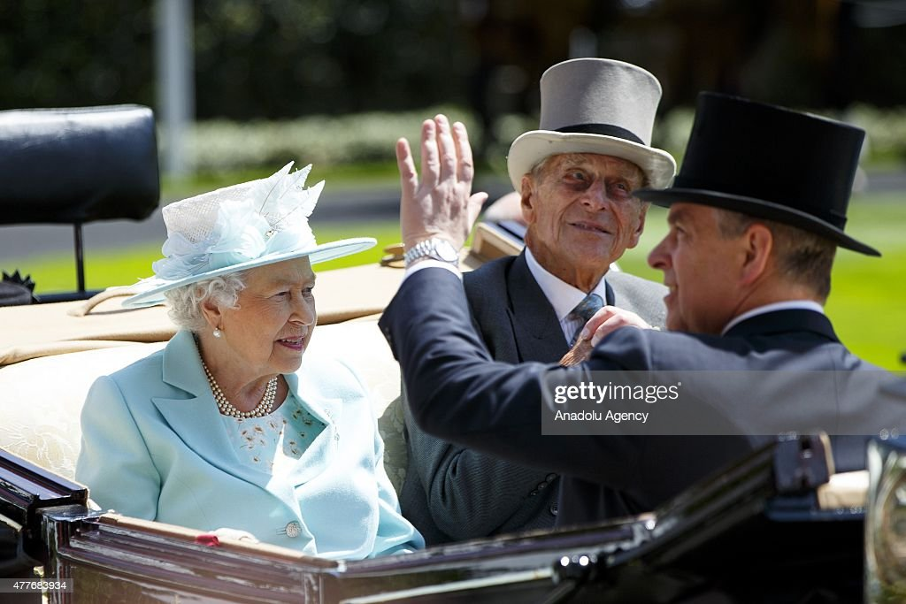 Queen Elizabeth II and Duke of Edinburgh Prince Philip arrive in a carriage for Ladies Day of Royal Ascot at Ascot racecourse in Berkshire, England on June 18, 2015. The 5 day showcase event, which is one of the highlights of the racing calendar, has been held at the famous Berkshire course since 1711 and tradition is a hallmark of the meeting. Top hats and tails remain compulsory in parts of the course.