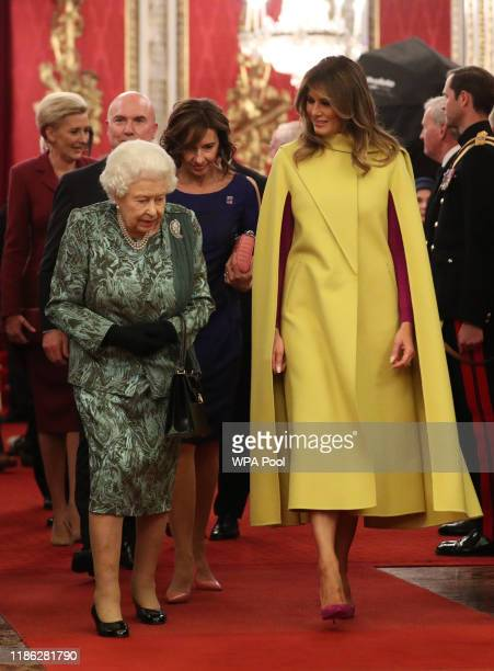 Queen Elizabeth II and First Lady Melania Trump attend a reception for NATO leaders hosted by Queen Elizabeth II at Buckingham Palace on December 3...