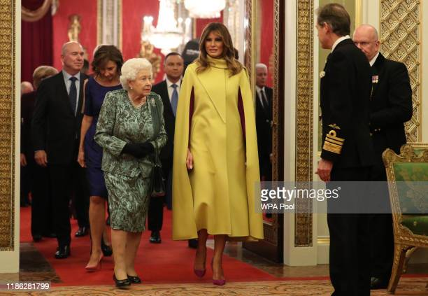 Queen Elizabeth II and First Lady Melania Trump attend a reception for NATO leaders hosted by Queen Elizabeth II at Buckingham Palace on December 3,...
