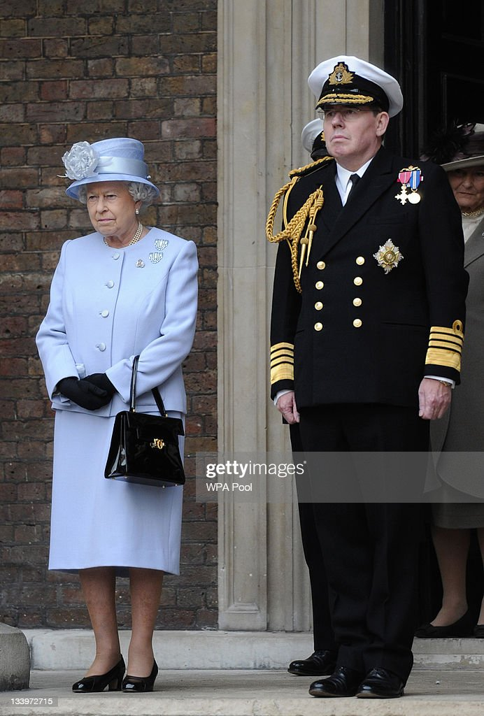 Queen Elizabeth II and First Sea Lord, Admiral Sir Mark Stanhope observe a ceremony during a visit to the Admiralty Board and Admiralty House on 23 November, 2011 in London, England. The Duke of Edinburgh was inaugurated as Lord High Admiral as well as formally receiving the Letters Patent, followed by a lunch given by the First Sea Lord at Admiralty House.