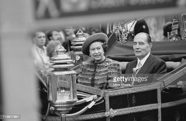 Queen Elizabeth II and Francois Mitterrand in a carriage during a state visit by the French President London 23rd October 1984