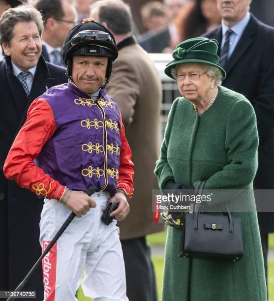 Queen Elizabeth II and Frankie Dettori during the Dubai Duty Free Spring Trials at Newbury Racecourse on April 13, 2019 in Newbury, England.