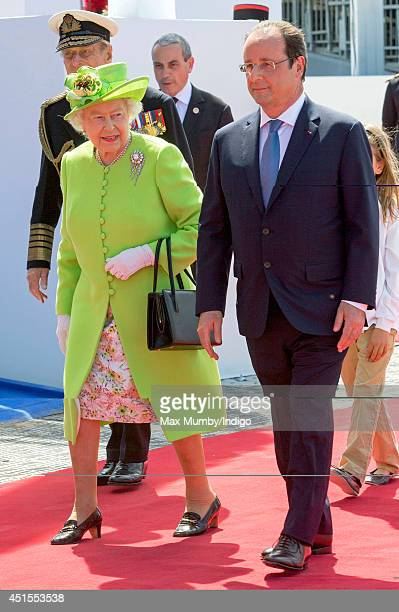 Queen Elizabeth II and French President Francois Hollande attend the International Ceremony at Sword Beach to commemorate the 70th anniversary of the...