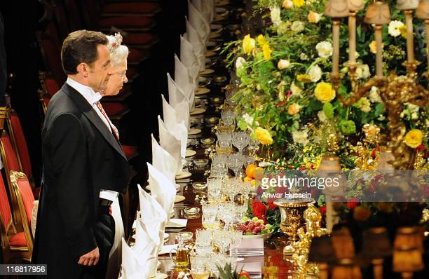 Queen Elizabeth II and French President Nicolas Sarkozy stand together during the state banquet on March 26 2008 at Windsor Castle in Windsor England...