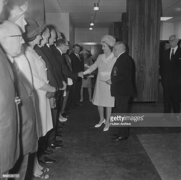 Queen Elizabeth II and German neurologist Ludwig Guttmann at Stoke Mandeville Hospital in occasion of the opening of the Stoke Mandeville Stadium...