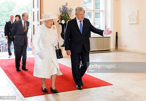 Queen Elizabeth II and German President Joachim Gauck arrive at the Schloss Bellevue Palace on the second day of a four day State visit to Germany on...