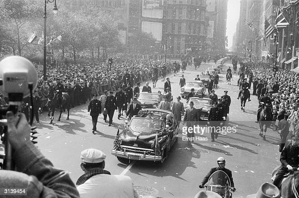 Queen Elizabeth II and her entourage make their way through New York City during an official visit to the States