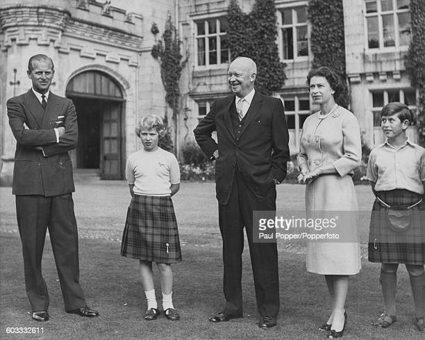Queen Elizabeth II and her family Prince Philip Duke of Edinburgh Princess Anne and Prince Charles standing with President of the United States...