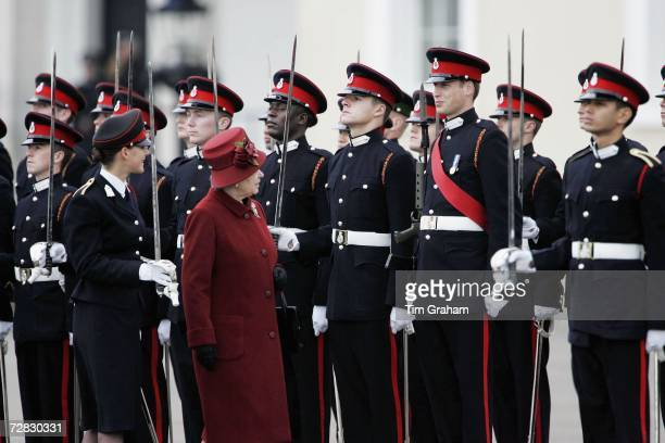 Queen Elizabeth II and her grandson Prince William smile as she inspects soldiers at the passing-out Sovereign's Parade at Sandhurst Military Academy...