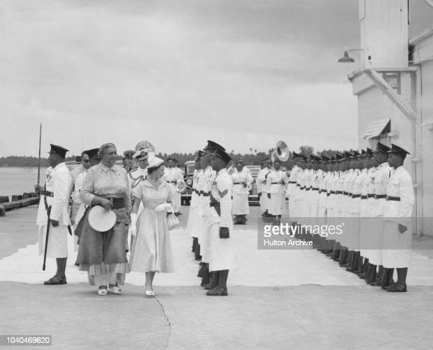 Queen Elizabeth II and her host Queen Salote Tupou III inspecting the Royal Guard on Elizabeth's arrival at Nuku'alofa Tonga during her coronation...