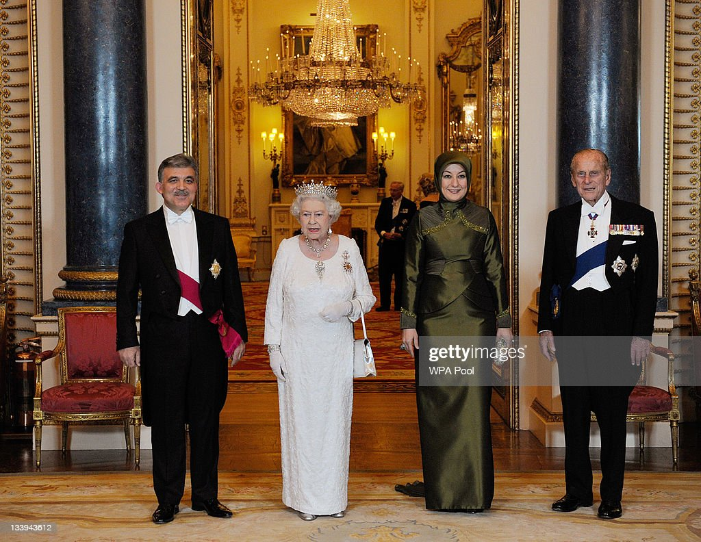 Queen Elizabeth II (2ndL) and her husband Prince Philip, Duke Of Edinburgh (R) pose for a formal picture with President of Turkey Abdullah Gul (L) and his wife Hayrunnisa Gul (2ndR) during a State Banquet at Buckingham Palace, on November 22, 2011 in London, England. President Abdullah is on a three day state visit to the UK and was formally welcomed by Queen Elizabeth and The Duke of Edinburgh today.