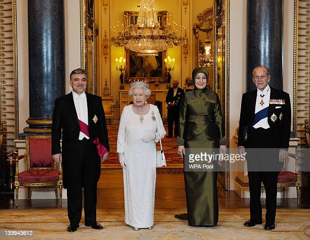 Queen Elizabeth II and her husband Prince Philip Duke Of Edinburgh pose for a formal picture with President of Turkey Abdullah Gul and his wife...