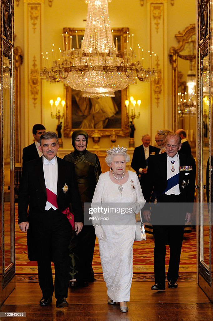 Queen Elizabeth II (2ndR) and her husband Prince Philip, Duke Of Edinburgh (R) prepare to pose for a formal picture with President of Turkey Abdullah Gul (L) and his wife Hayrunnisa Gul (2ndL) during a State Banquet at Buckingham Palace, on November 22, 2011 in London, England. President Abdullah is on a three day state visit to the UK and was formally welcomed by Queen Elizabeth and The Duke of Edinburgh today.
