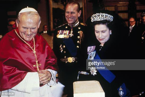 Queen Elizabeth II and her husband Prince Philip, Duke of Edinburgh with Pope John Paul II during the royal tour of Italy, 1980.