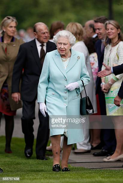 Queen Elizabeth II and her husband Prince Philip Duke of Edinburgh arrive at Chelsea Flower Show press day at Royal Hospital Chelsea on May 23 2016...