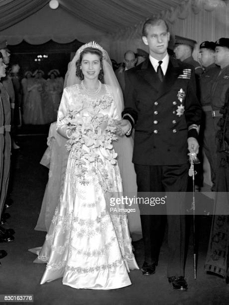 Queen Elizabeth II and her husband Prince Philip Duke of Edinburgh leave Westminster Abbey after the wedding ceremony