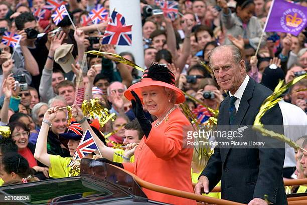 Queen Elizabeth II And Her Husband Prince Philip Ride Along The Mall In An Opentop Car As They Return To Watch A Parade Outside Buckingham Place