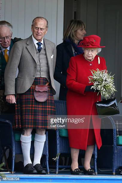 Queen Elizabeth II and her husband Prince Philip stand to leave the Braemar Gathering on September 5 2015 in Braemar Scotland There has been an...