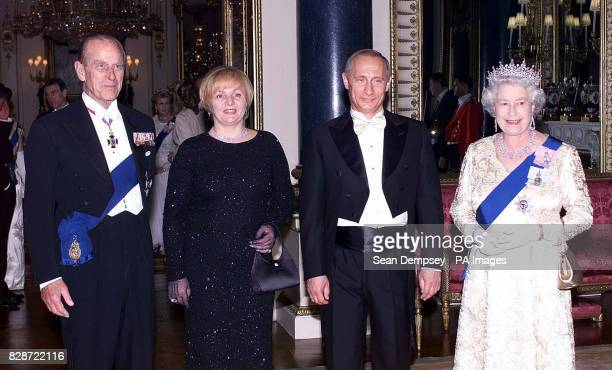 Queen Elizabeth II and her husband, the Duke of Edinburgh stand alongside Russias President Putin and his wife, Lyudmila, before a state banquet at...