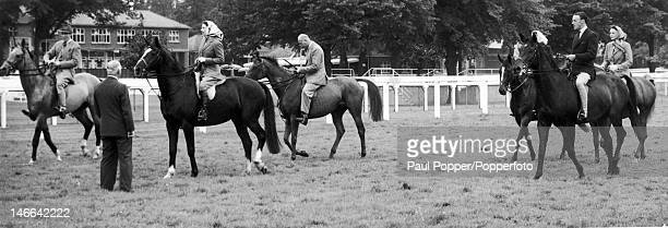 Queen Elizabeth II and her party on Ascot racecourse 16th June 1960 From left to right Lord Porchester the 16th Duke of Norfolk the Queen the Duke of...