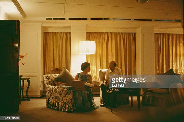 Queen Elizabeth II and her Private Secretary Sir Martin Charteris reviewing papers late at night on board HMY Britannia 18th March 1972 Part of a...