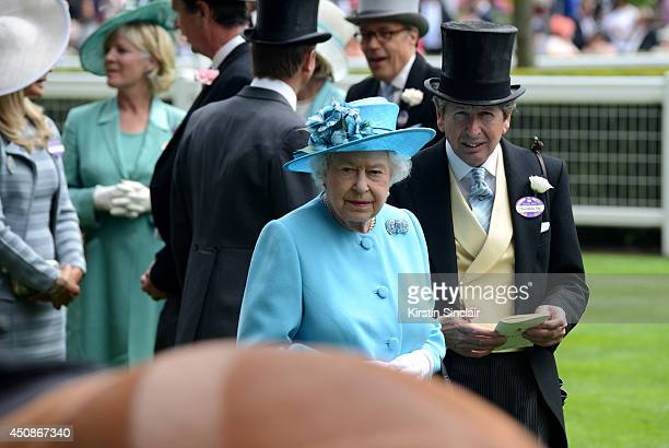 Queen Elizabeth II and her Racing Advisor John Warren attend day three of Royal Ascot at Ascot Racecourse on June 19 2014 in Ascot England