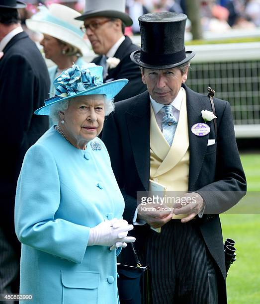 Queen Elizabeth II and her Racing AdvisorJohn Warren attend day three of Royal Ascot at Ascot Racecourse on June 19 2014 in Ascot England