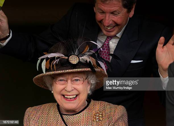 Queen Elizabeth II and her racing manager John Warren watch her horse 'Sign Manual' win the Dreweatts Handicap Stakes as she attends the Dubai Duty...