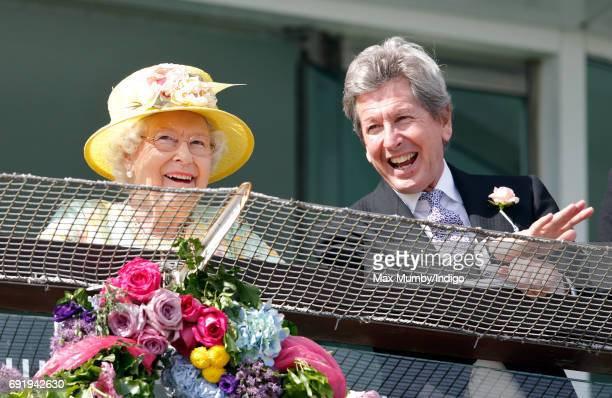 Queen Elizabeth II and her racing manager John Warren watch the racing as they attend Derby Day during the Investec Derby Festival at Epsom...