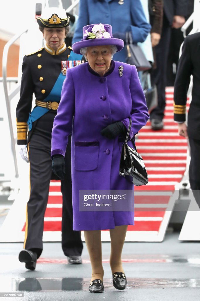 Queen Elizabeth II and Her Royal Highness The Princess Royal attend the Commissioning Ceremony of HMS Queen Elizabeth at HM Naval Base on December 7, 2017 in Portsmouth, England.
